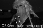 David Allan Coe on stage at Kelly's