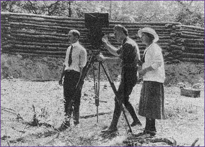 Elizabeth Grimball, the director of the 1921 film on the Lost Colony, is shown with the cinematographer in this undated newspaper clipping. A native of North Carolina, Grimball was hired by the Atlas Film Company to direct the production.