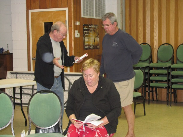 """Actors Don Bridge, Julie Sawyer, and Glenn Sawyer are hard at work learning their lines for Theatre of Dare's production of 'Dial """"M"""" for Murder', directed by Julia Scheer. (photo: Theatre of Dare)"""