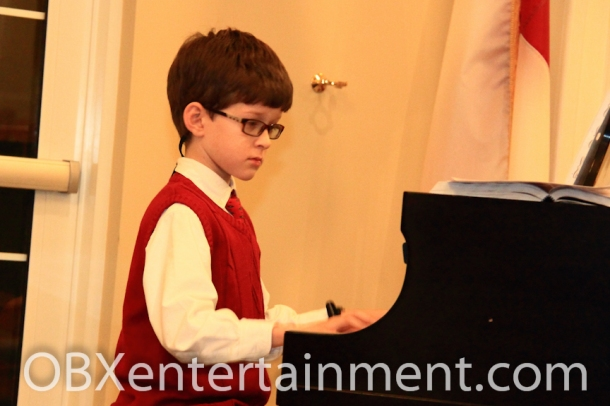 Ten-year-old Will Haresch performed at the 4th Annual Violins & Voices Christmas Concert fundraiser on Dec. 1, 2012 in Nags Head.