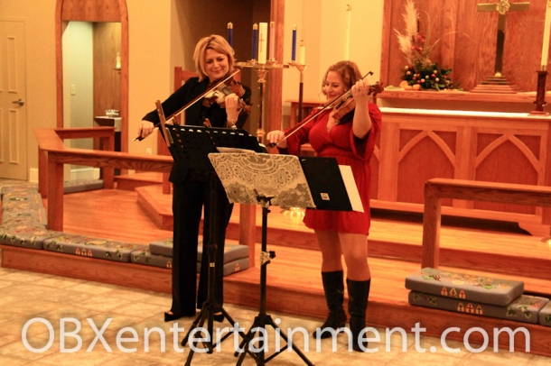 Violinists Stacey Walters and Sue Artz performed at the 4th Annual Violins & Voices Christmas Concert on Dec. 1, 2012 in Nags Head.