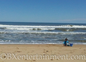 Ozzie Artz enjoys a day on the beach in Nags Head, NC.