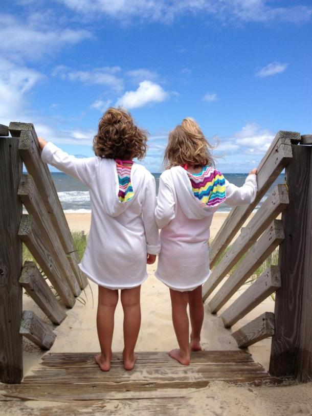 Village Realty's 2013 Photo Contest Grand Prize Winner features cousins Kalynn and Ryleigh enjoying their last day on the beach, by Amanda Robenolt .