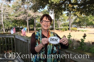 Roanoke Island Festival Park Communications Director Tanya Young shows off her OBXentertainment.com decal. (photo: OBX Entertainment)