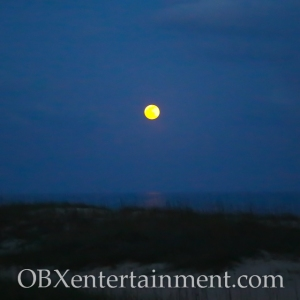 A full moon over Hatteras Village, North Carolina on Cape Hatteras National Seashore. (photo by OBXentertainment.com)
