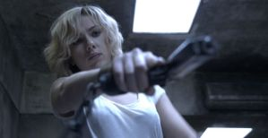 Scarlett Johansson takes aim in 'Lucy'.