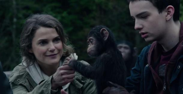 Keri Russell and Kodi Smit-McPhee make a new friend in 'Dawn of the Planet of the Apes'.