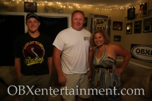 Sue Artz with Wanchese Woods owner Bud Elkins and his nephew David on the set of the OBX Entertainment series 'OBXE TV' on September 1, 2014. (photo by OBXentertainment.com)