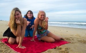 Marvel Ann (Ana Figiel), Berdine (Addie Moore), and Chicklet (Lauren Taylor) go man hunting on the beach.