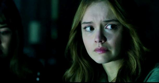 Olivia Cooke plays with the 'Ouija' board.