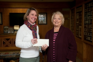Emily Lewis of Village Realty presents a check for $10,000 to the Outer Banks Angel Gift Fund.
