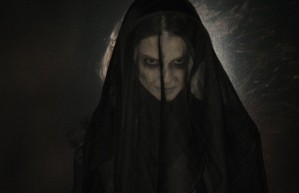 'The Woman in Black' returns in 'Angel of Death'.