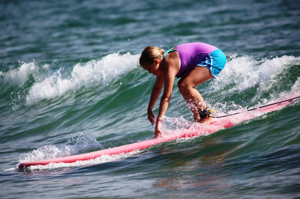 Learning to ride small waves is perhaps one of the children's favorite activities during summer camps at Jennette's Pier. Registration for all summer camps at Jennette's Pier, as well as the N. C. Aquarium on Roanoke Island, opens Monday, March 2 at 9 a.m. (photo courtesy Jennette's Pier)