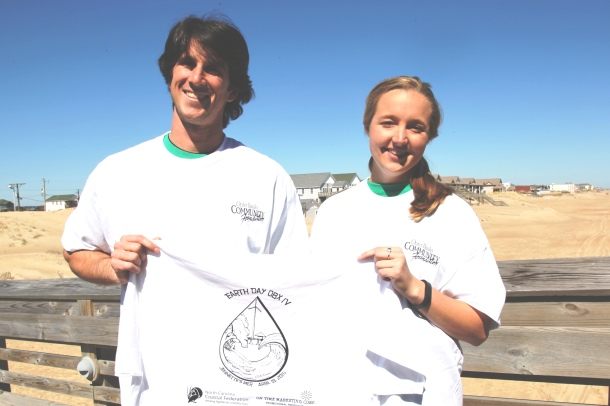 Earth Fair OBX IV organizer Jim Gould and summer educator Jess McKeowen show off the T-shirt design for this year's free event. Participants who visit more than eight stations are awarded one of the shirts, which they can tie-dye.